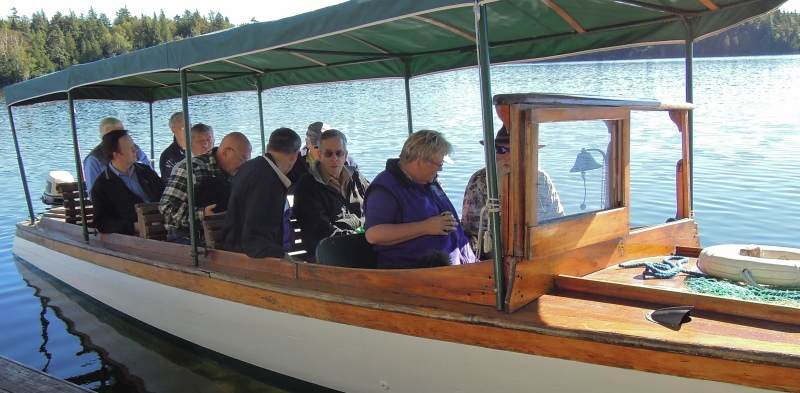 Snapshot : Minnowbrook 2013 boat trippers on launch so old it needs an outboard